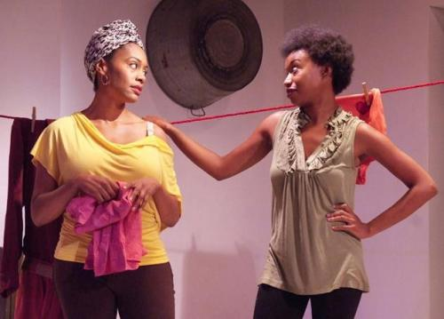 "Maya Lynne Robinson (right) as Nia, Simone Missick (left) as Shun, in ""In the Red and Brown Water"" at the Fountain Theatre"