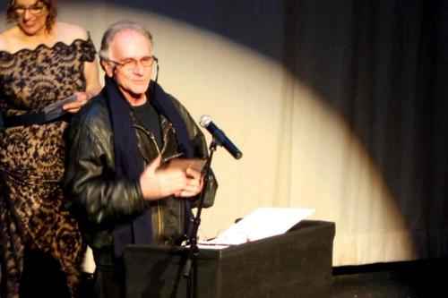 Simon Levy accepts Best Director Award for 'Cyrano'.