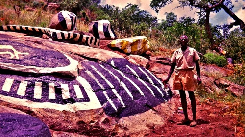 Nukain Mabuza on his hillside of painted rocks.