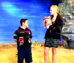 "Lexi lallatin with Ramona School student on the set of 'Painted Rocks""."